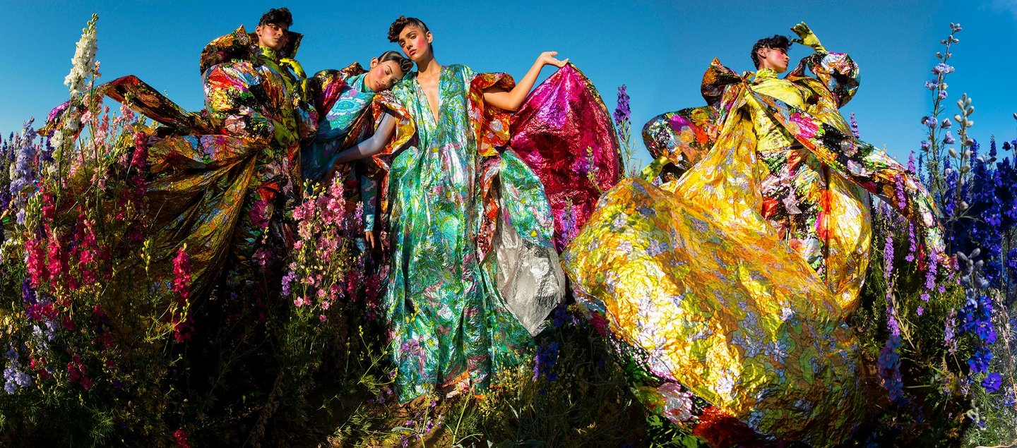 Tim Walker brightly coloured fashion photograph in a field