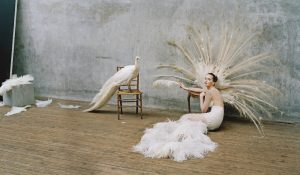 Tim Walker photograph of woman in white dress with bird